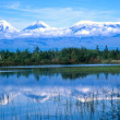 Stock Photo: Kamchatkvolcanoes mirrored in lake