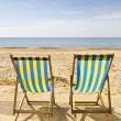 Two deck chairs on beach — Stock Photo #11291216