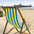 Single deck chair on beach — Stock Photo #11291338