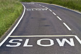 Slow signs on the road — Stock Photo