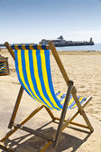 Single deck chair on the beach — Stock Photo