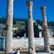 Detail of marble column of Ephesus, ruins, with deep blue sky in background — Stock Photo
