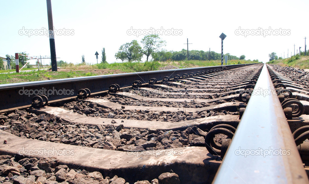 Steel railway through the green field close view — Stock Photo #11306319