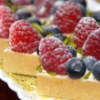 Cheese cake with raspberry and blueberry - Stock Photo