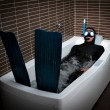 Diver in bathtub immersion - Stock Photo