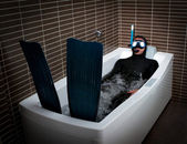 Diver in bathtub immersion — Stok fotoğraf