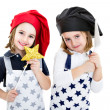 Twins cook chef with cook equipment magical wand — Stock Photo