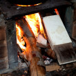 Stock Photo: Close of flames on wood stove
