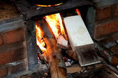 Close of flames on wood stove — Foto Stock