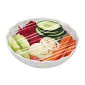 Bowl of vegetables and plants protected by plastic film — Stock Photo