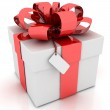 Gift box with red ribbon bow isolated on white background — Stock Photo