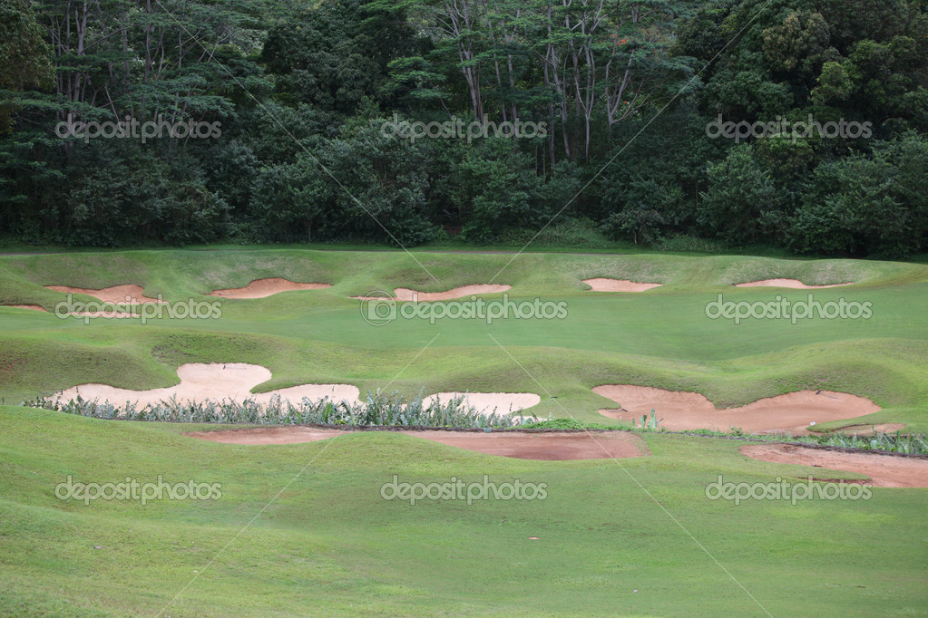 Bunkers around green of country golf course in hawaii  Stock Photo #11399071