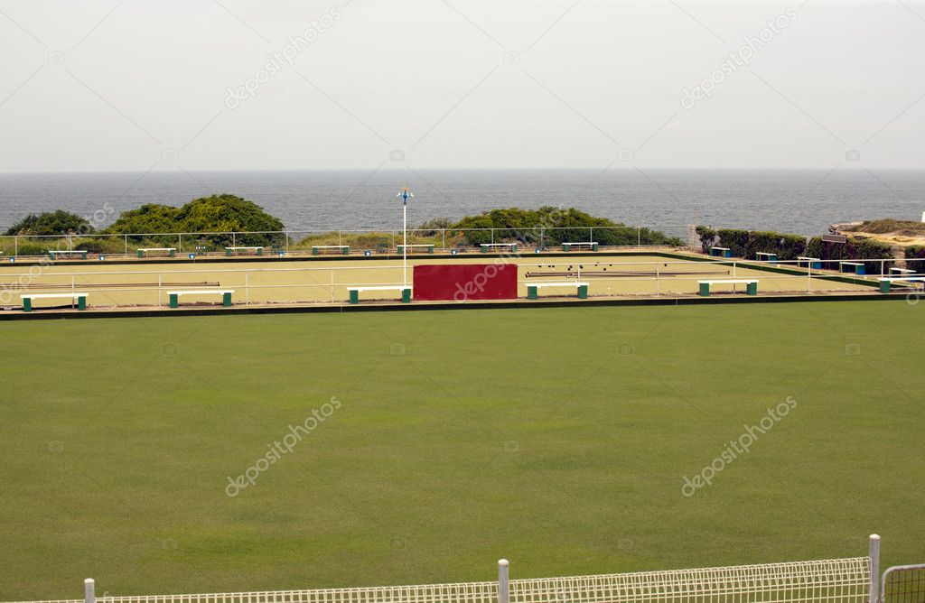 The lawn bowlers appear to have abandoned play and perhaps gone for a swim  Stock Photo #11808501