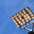 Sky blue stadium lights — Stockfoto #11897041