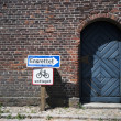 Stock Photo: Old brick wall and blue door