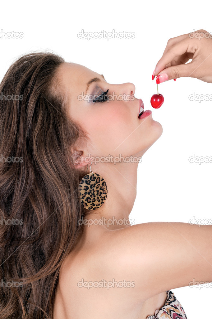 Beautiful model with cherry over isolated white background  Stock Photo #11055617