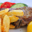 Grilled steak with french fries — Stock Photo #11451116