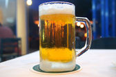 Mug of cold beer from the frost — Stock Photo