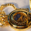 Gold pocket watch with chain — Stock Photo
