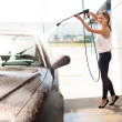 Young woman washing the car — Stock Photo