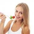 Pretty Girl eating salad. Isolated — Stock Photo