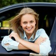 Young happy driver sitting in car — Stock Photo