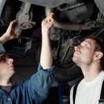 Two Car Mechanic repairing car — Stock Photo