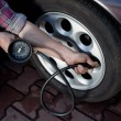 Stock Photo: Tire pressure check