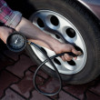 Tire pressure check — Stockfoto #11984690