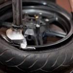 Motorcycle tire repair — Stock Photo