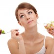 Sad woman on diet with vegetables — Stock Photo #11985671