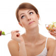 Sad woman on diet with vegetables — Stock Photo