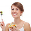 Woman with salad on fork, isolated — Stock Photo