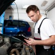 Auto mechanic checking car in service — Stock Photo #11986001
