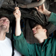 Car Mechanics repairing car — Stock Photo #11986077