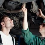 Car Mechanics repairing car — Stock Photo