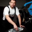 Mechanic fixing tyre in car service — Stock Photo #11986179