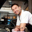 Mechanic based on car smiling — Stock Photo #11986270