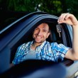 Young man with keys of new car smiling — Stock Photo #11986953