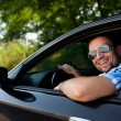 Young man in car smiling — Stock Photo #11986956