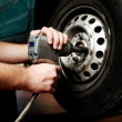 Changing wheel on car - Stock Photo
