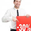 Young Businessman with red blank sign smiling — Stock Photo
