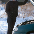 Man with broken car in winter — Stock Photo