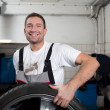 Mechanic smiling at work — Stock fotografie