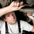 Auto mechanic working under car — Stock Photo #11989594
