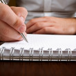 Businessman writing with pencil — Stock Photo #11989949
