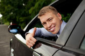 Driver thumbs up — Stock Photo