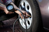 Tire pressure check — Foto de Stock