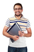 Young student with laptop smiling — Stock Photo