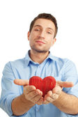Young student with heart — Stock Photo